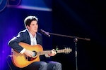 Jake sings a song at a show held on Zhongbei Campus - ECNU.