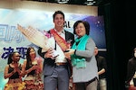 Jake wins the first prize at an ECNU's Talents Show.