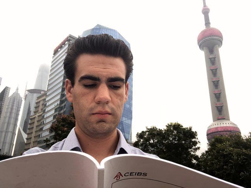 A CEIBS Student reading the school handbook